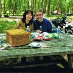 Cleo and Gregg pause for a picnic during their sidecar tour.