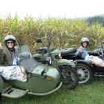 Sisters Mary & Barbara enjoy the morning air from sidecars.