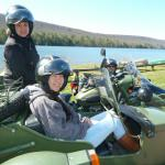 Bill, Rhoda, and 14 year old Micaela from Wilton, Conn. taking in the views from the seat of a sidecar.