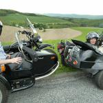 Vera, Chris, and Peanut from Wharton, N.J. are one happy family while enjoying the sights from a sidecar.